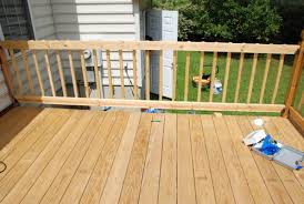 lively green door deck balusters are up