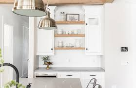 glass shelf between kitchen cabinets white cabinets with blond wood shelves transitional kitchen