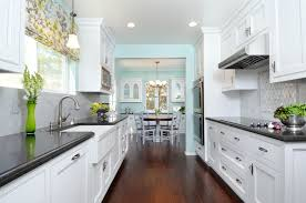 white galley kitchen design end eating area home ideas
