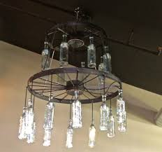 vintage wagon wheel chandelier use glass bottles for wagon wheel