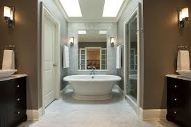 bathroom baseboard bathroom traditional with wall sconce white