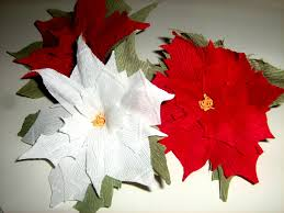 crepe paper poinsettia red white flower christmas decoration photo