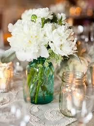 blue mason jar wedding centerpiece with white flowers ipunya