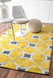 rectangle yellow and grey rug in leaves accent under white acrylic