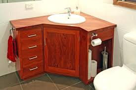 corner bathroom vanity powder room with chocolate cabinets