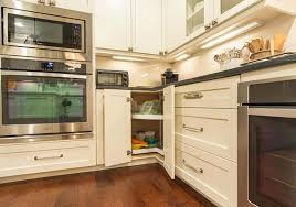 kitchen with white cabinets featured lazy susan and using
