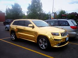 gold jeep cherokee gold wrapped jeep grand cherokee