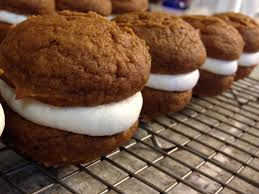 pumpkin whoopie pies with maple cheese filling the dough