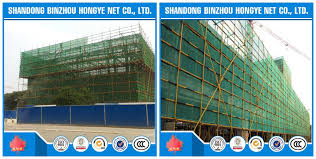 green and yellow construction safety netting scaffolding safety