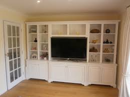 modern media room with white shelving unit for ikea storage bins
