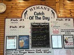 this board at hyman s seafood shows the catch of the day