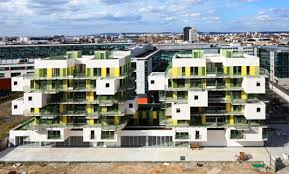 KOZ Completes  Green Literally And Yellow Stacked Apartments - Sustainable apartment design