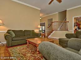 Rugs For Hardwood Floors by Traditional Living Room With Carpet U0026 Crown Molding In Ashburn Va