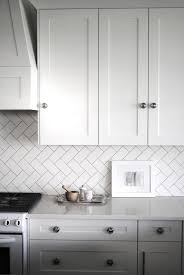 a classic and chic herringbone pattern in white subway tiles as