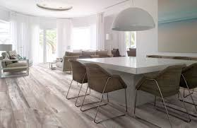 minimalist grey hardwood floors boosting your contemporary room awesome design of the grey hardwood floors for the dining room areas with white marble table