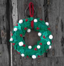 knitted christmas knitted christmas wreath with leaves berries and snowballs