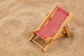 Small Beach Chair A Small Deck Chair Model On A Sandy Beach Symbolic Photo For