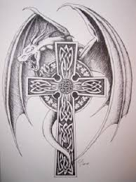 tattoo cross dragon these cross tattoos with wings are sure to look uniquely ethereal