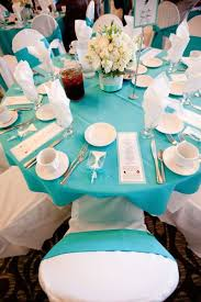 bling wedding programs blue turquoise guest table setup complete with wedding