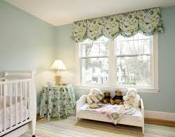 living room window decorated with balloon valances with tassels