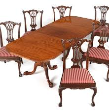 carved mahogany dining table six chippendale style side chairs ebth