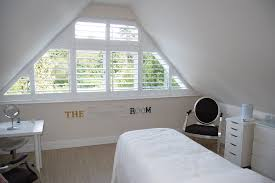 triangular shaped window which would be difficult to dress with