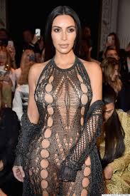 nude photos of kim kardashian kim kardashian wears see through mesh jumpsuit to balmain spring