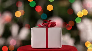 dolly shot of red present box against blurry lights gift for