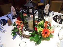 wedding lantern centerpieces fresh flowers in oasis or vials
