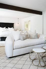 Spanish Style Bedrooms White Plush Curved Sofa With Moroccan Style Wool Rug