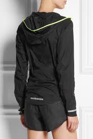nike impossibly light women s running jacket lyst nike impossibly light shell running jacket in black