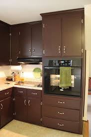 brown painted kitchen cabinets u0026 silver hardware looks like our