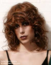 80s layered hairstyles long 80s inspired hairstyle with large voluptuous mahogany curls