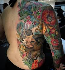 color flowers and aries tattoo on side rib and full sleeve by