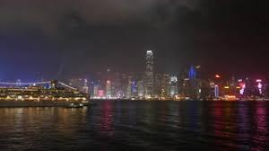 hong kong light show cruise hongkong light show at night time cruise liner ship on foreground