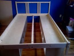 unfinished white oak wood bed frame with storage shelves of