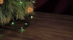 christmas branches with lights blurred background christmas garland on the fir tree branches soft