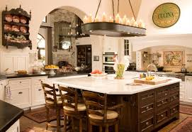 arched opening kitchen into adjacent room santa barbara style