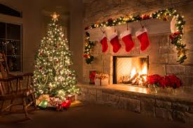 christmas decoration christmas glowing fireplace hearth tree red stockings gifts and