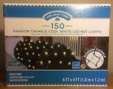 random twinkle led net lights holiday time random twinkle led net lights cool white blue 150 count
