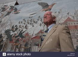 wildlife artist john ruthven with passenger pigeon mural on stock stock photo wildlife artist john ruthven with passenger pigeon mural on cincinnati ohio building