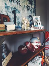 desk in boy u0027s bedroom with baskets of sports gear on wall our