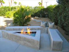 Fire Pit Crystals - raised stacked stone wall on swimming pool and gas firepit fire