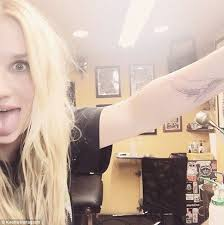 kesha debuts planet tattoo at new york state supreme court before