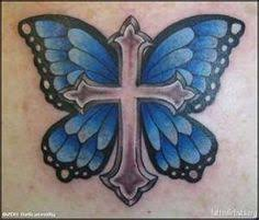cross with flowers and butterflies tattoos
