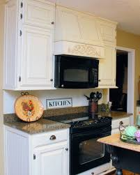 tuscan kitchen designed with granite countertops and black