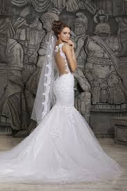 gorgeous mermaid wedding dress with tulle train and open back
