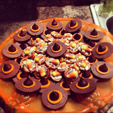cute halloween snacks witchy hats and pretzel candy corn hugs