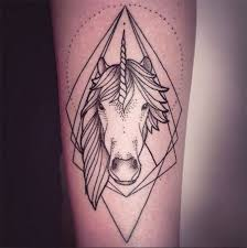amazing uncolored unicorn on geometric figure background tattoo on