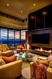 mountain home with scenic views by kevin b howard architects view in gallery cozy living room of the mountain home with modern fireplace and stiunning views